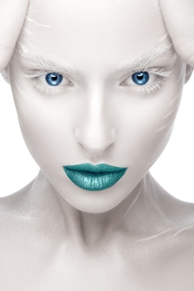 Beautiful girl in the image of albino with blue lips and white eyes.  Art beauty face.